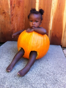 black baby in pumpkin