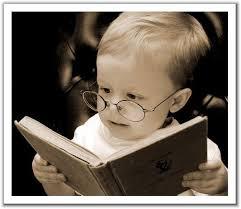 Cute baby reading! Photo: worksmartlivesmart.com