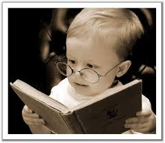 Cute baby reading! Photo: worksmartlivesmart.com