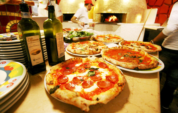 Pizza at Eataly NYC (Photo Credit: New York Times)