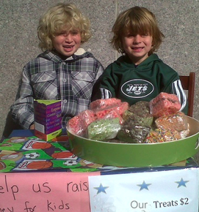 His two adorable sons Dan and Eli having a bake sale.